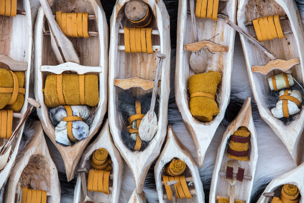 miniature whittled canoes
