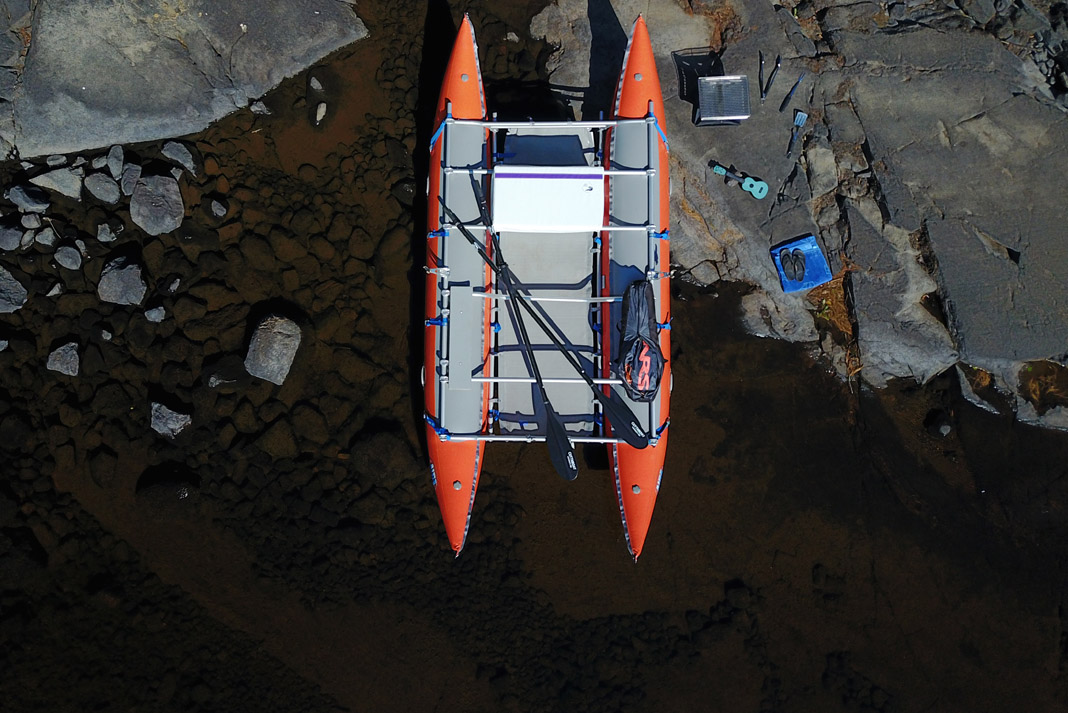 an oar rig surrounded by paddling gear