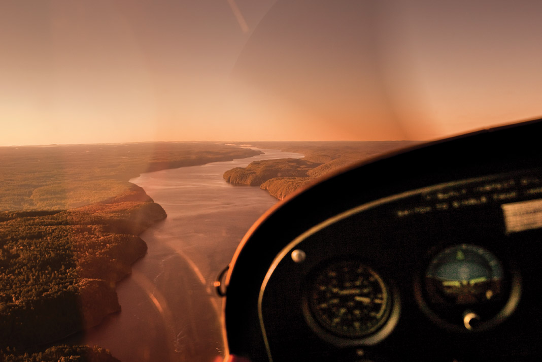 view of a river from a planes cockpit