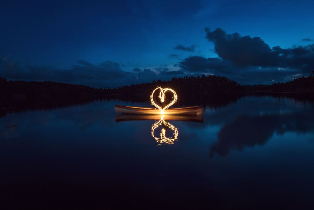 a heart made by light from a canoe