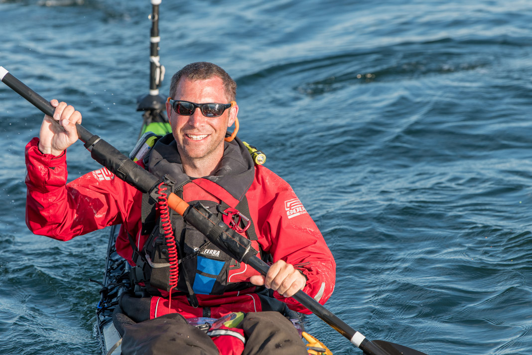 Matt Pruis smiling in a kayak