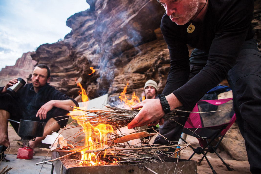 man building a small fire