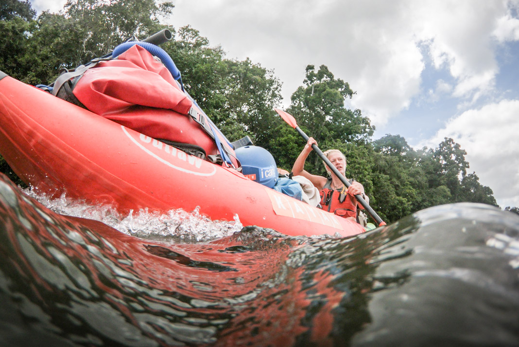 woman paddling in raft
