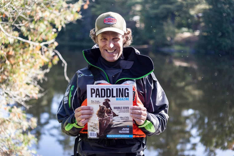 Scott MacGregor holding paddling magazine
