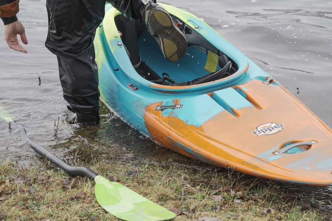orange and blue Pyranha ripper kayak